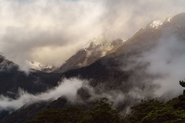 Beauty In Nature Cloud - Sky Day Fiordland Fiordland National Park Landscape Mountain Mountain Range National Park Nature No People Outdoors Scenics Sky Snow Waterfall EyeEmNewHere