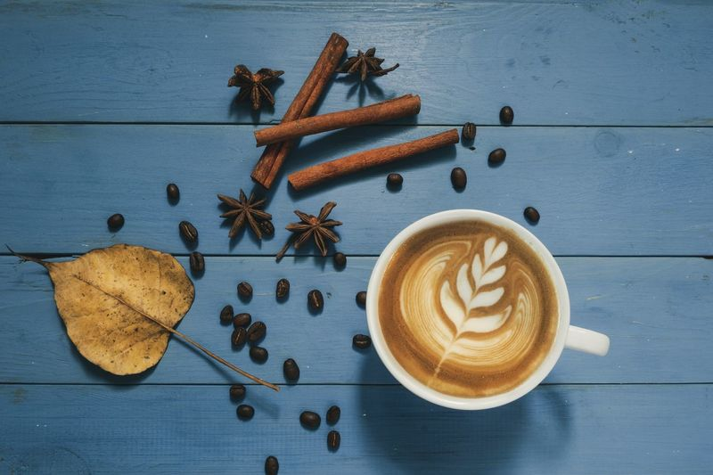 Latte art coffee on blue light wood background Vintage Wallpapers Hot Drink Latte Art Food And Drink Coffee Coffee - Drink Food Drink Spice Cup Still Life Coffee Cup Refreshment Mug Creativity Table Latte Hot Drink Wood - Material No People Directly Above Cinnamon Freshness
