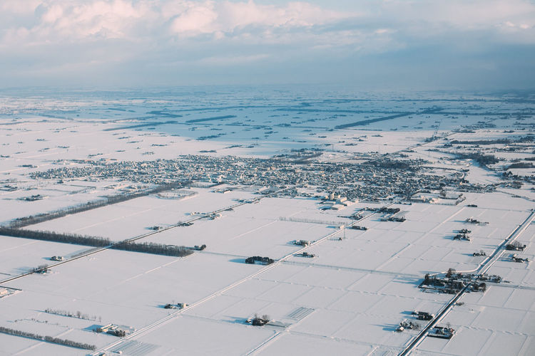 Freezing Hokkaido Japan Sky And Clouds Travel Winter Aerial View Beauty In Nature Blue Sky Canon City Cloud - Sky Day High Angle View Landscape Nature Outdoors Scenics - Nature Sky Skyscraper Snow Tourism Tranquil Scene Tranquility View Into Land