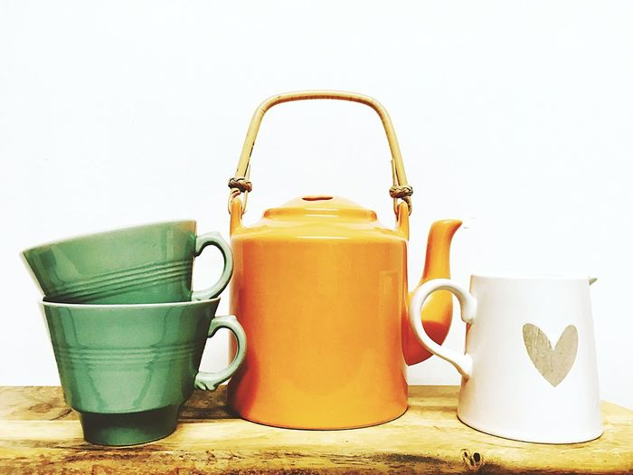 Teatime colours Teatime Teapot Tea Cup Orange Teapot Green Cup Still Life No People Indoors  White Background Yellow Clear Sky Close-up Freshness