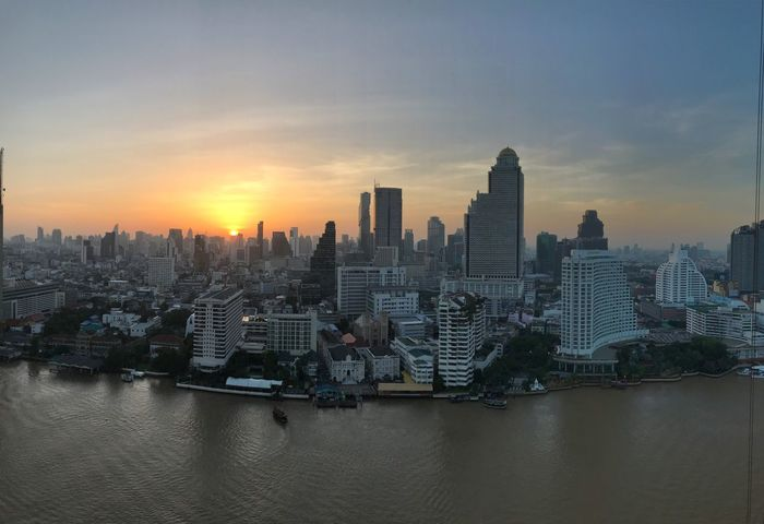 Sunrise Skyscraper Building Exterior Architecture Cityscape City Modern Waterfront Bangkok Travel Destinations Chaophraya River Downtown District Outdoors Sky Urban Skyline Water Development Built Structure River The Week On EyeEm