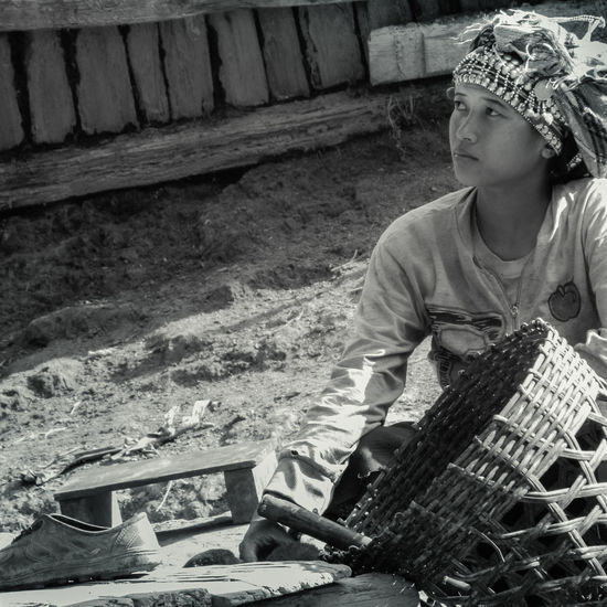 Girl in Lao village Anthropology Childhood Girl Lifestyles One Person Outdoors Sitting Traditional Clothing Tribal Tribal Village Wicker Basket