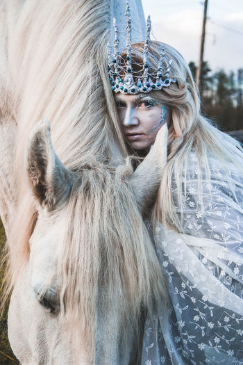 Portrait of a girl with a horse. In the photo an animal and a man. Work with makeup. Daylight. People Watching Adult Animal Animals Beautiful Woman Blond Hair Clothing Day Hair Hairstyle Horse Long Hair Looking At Camera One Person Outdoors People people and places Portrait Real People Waist Up Warm Clothing Winter Women Young Adult Young Women