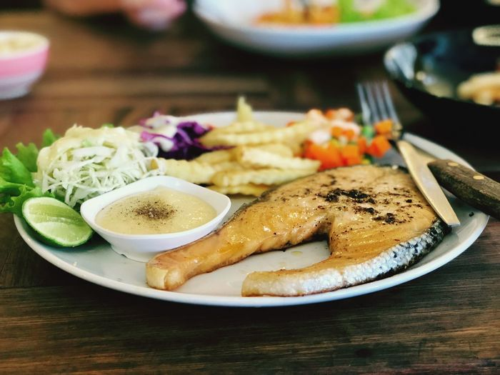 Salmon steak 🍳 #camera #i8+📱 Food And Drink Plate Food Ready-to-eat Serving Size Freshness Table Indoors  Healthy Eating No People Bowl Meal Focus On Foreground Indulgence SLICE Meat Vegetable Close-up Selective Focus Temptation