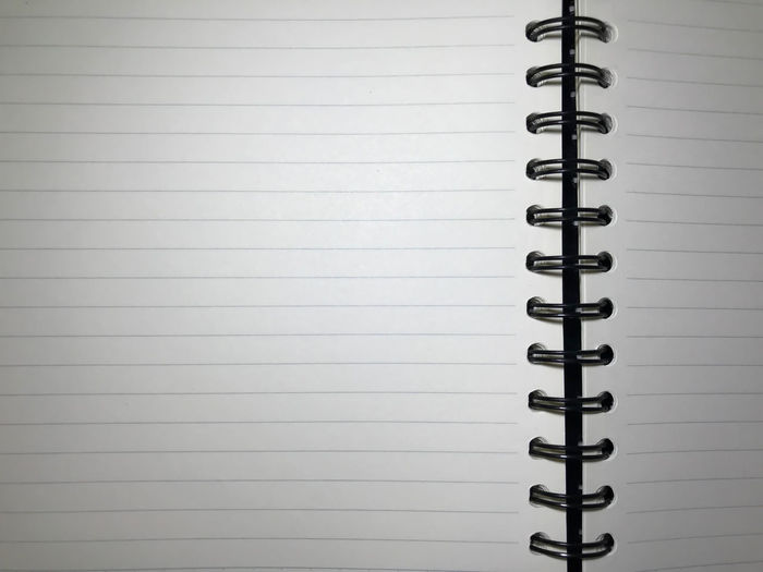 Top view of open spiral blank notebook on white desk background The shadow of the lamp. Overtime - Can be used for display or montage your production. Presentation of advertising ideas. Measurement Blank Close-up Copy Space Drawing Education In A Row Indoors  Lined Paper No People Note Pad Office Supply Page Paper Paper Currency Presentation Reminder Ring Binder Spiral Spiral Notebook To Do List