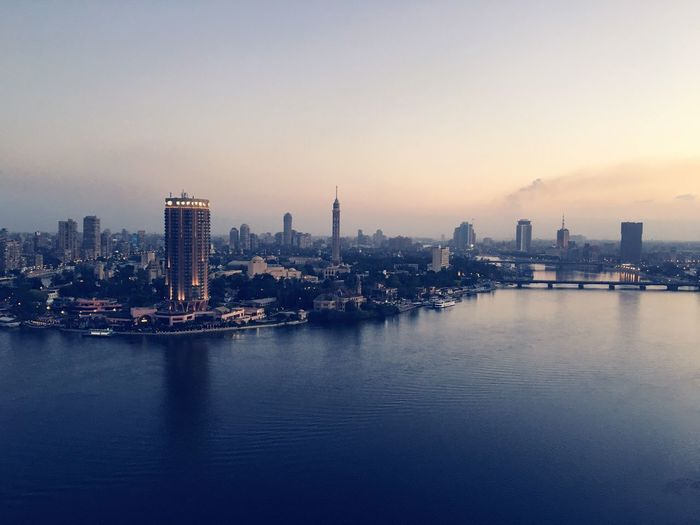 City Building Exterior Architecture Built Structure Cityscape Skyscraper Urban Skyline Modern Tower Outdoors Waterfront No People Travel Destinations River Nile River Cairo Egypt Dawn Lowlight Reflection Water Water Reflections Adapted To The City