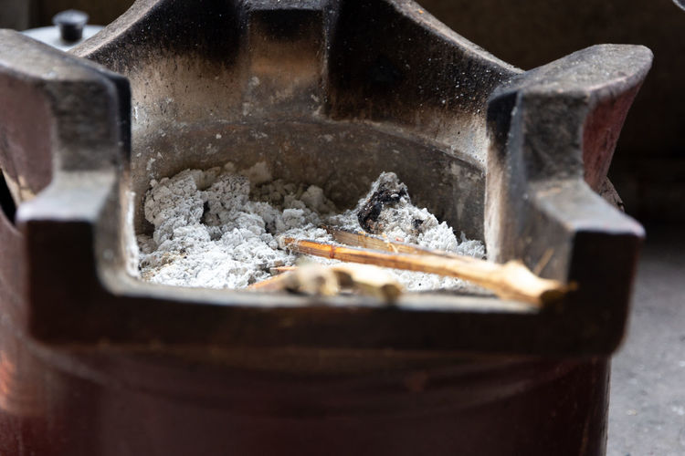 old asian stove with burn charcoal Close-up No People Cigarette  Ashtray  Smoking Issues Social Issues Cigarette Butt Burnt Bad Habit Indoors  Ash Warning Sign Sign RISK Communication Food Food And Drink Selective Focus