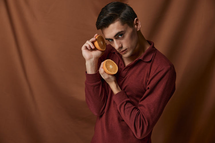 Portrait of young man holding ice cream