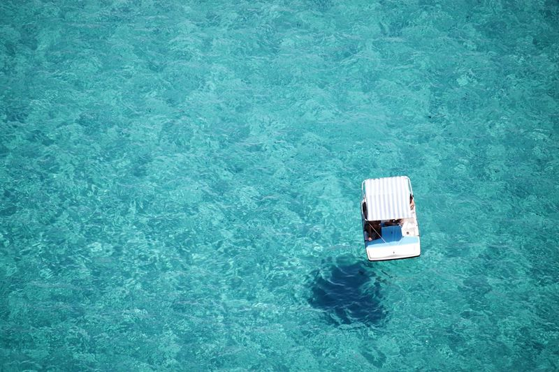 Directly above shot of pedal boat on sea during sunny day
