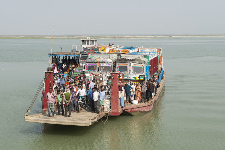 Crowded ferry across the Ganges River is approaching the pier of Rajmahal, Bihar Pier Waterfront Day Crowd Ganges River Bihar India Overpopulation Outdoors Crowd Of People Passenger Car Trucks Ferry Boat Real People Mode Of Transportation Large Group Of People Transportation Nautical Vessel Group Of People Water EyeEmNewHere Editorial Use Only