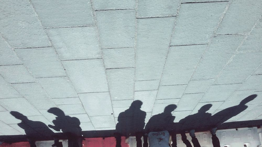 Urban Urbanexploration Urban Scene Upside Down Photography In A Row Streetphoto_color People Shadow People On The Street Sitting Outside EyeEmNewHere Human Body Part Film Is Not Dead Textures And Patterns Second Acts Real People Togetherness The Graphic City Visual Creativity