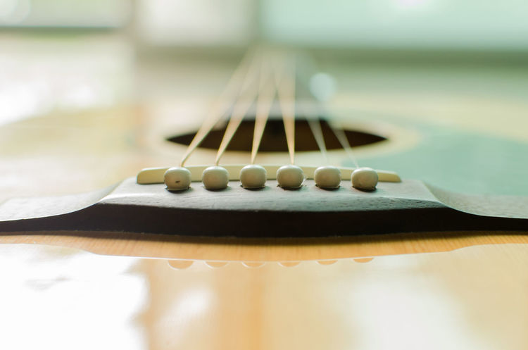 acoustic guitar and six string line Acoustic Guitar Acoustics Close-up Day Guitar Guitarist Indoors  Music Musical Instrument Musical Instrument String No People Sound Woodwind Instrument