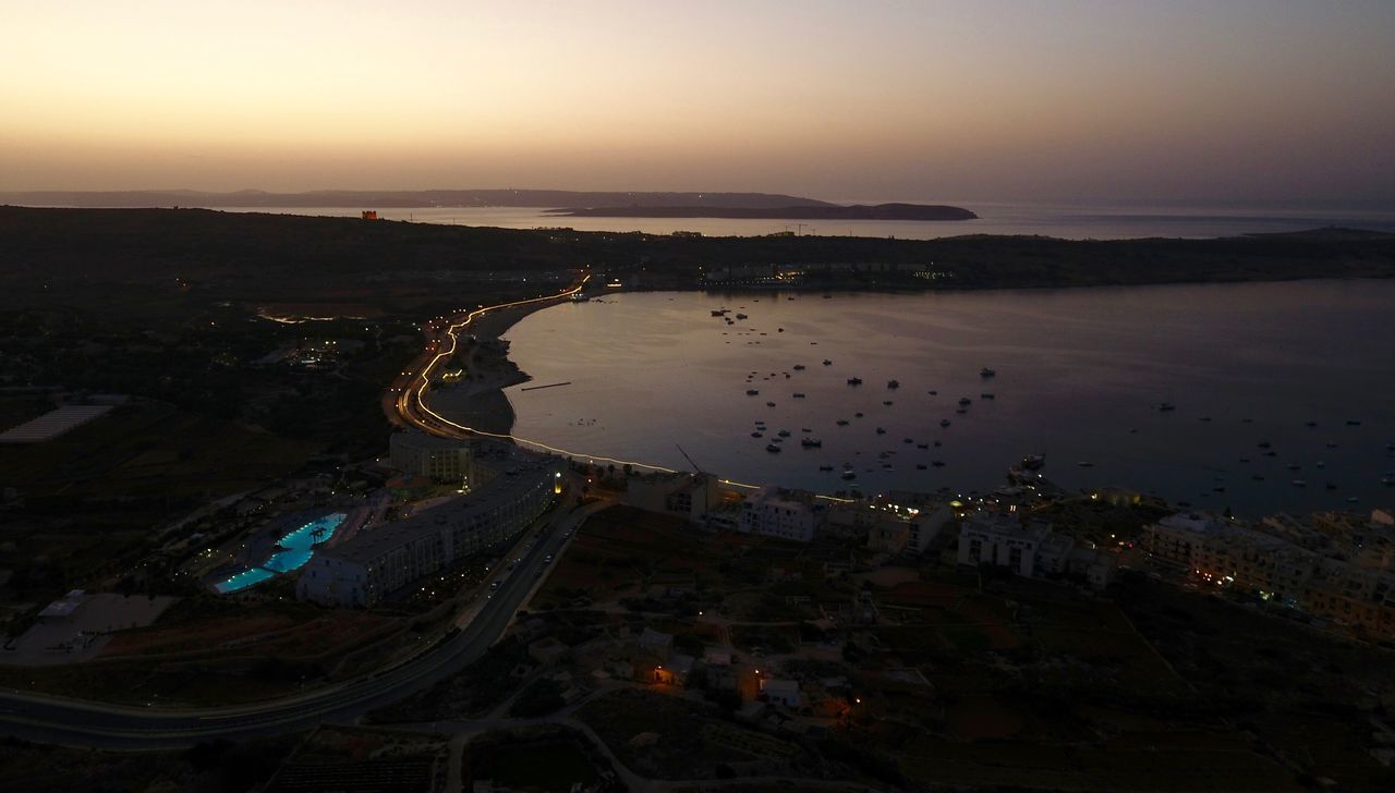 sky, water, architecture, building exterior, city, built structure, sunset, cityscape, high angle view, nature, no people, sea, aerial view, scenics - nature, outdoors, dusk, building, beach, land