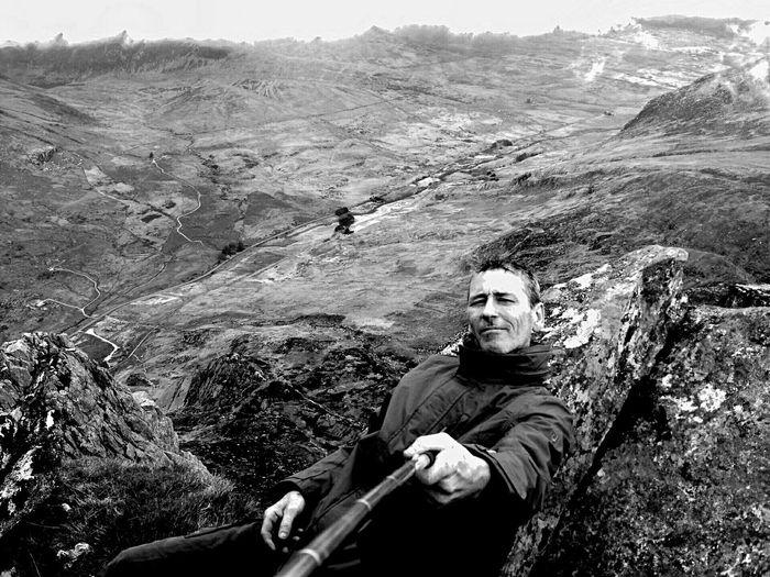 Portrait Of Man Talking Selfie On Mountain