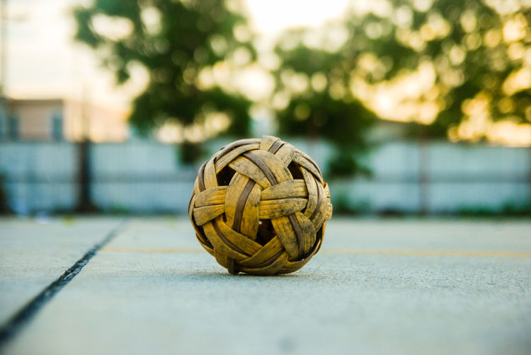Close-up of wicker ball against sky