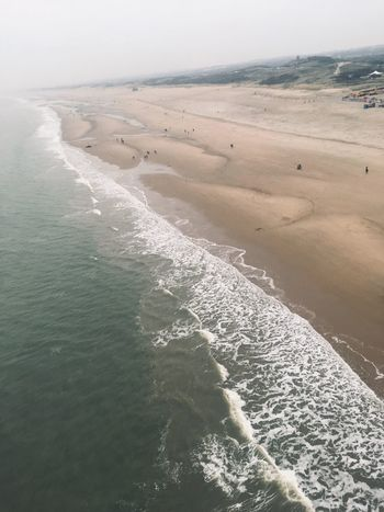 Water Beach Sea Land Beauty In Nature Scenics - Nature Sport Sand Motion Nature Wave Day Aquatic Sport Tranquility Surfing High Angle View Tranquil Scene Idyllic Sunlight Outdoors