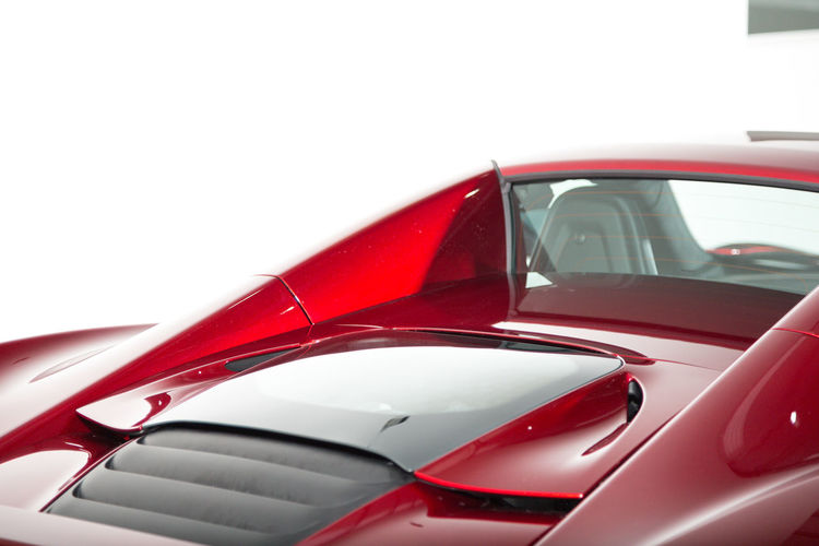 Close-up of red car against white background