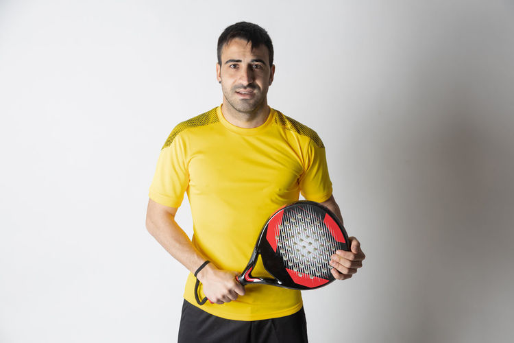 Portrait of man with ball in background