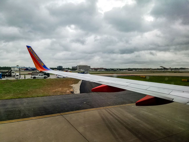 Outdoors Day Cloud - Sky Sky Plane Landing Plane Clouds Airportphotography Aircraft Wing Commercial Airplane Southwest Airlines May 2017 Motion Transportation Window Seat Window Seat Airplane Wing Landscape Airport Runway Airport Runway Landing No People Flying Airplane Air Vehicle The Traveler - 2018 EyeEm Awards