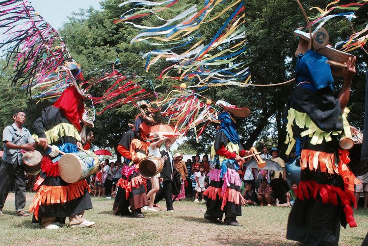 People In Costume Celebrating Festival At Park