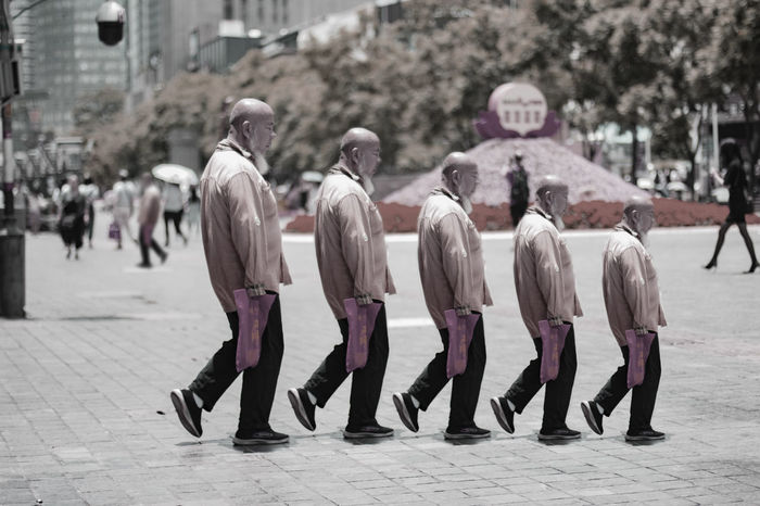 Wide Angle Chinese Bald Old Man Lowsaturation Red Flowers City Police Force Full Length Army Soldier Togetherness Rear View Marching