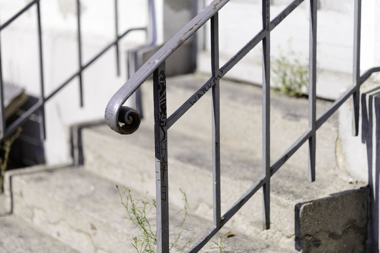 Close-up of metal railing on steps