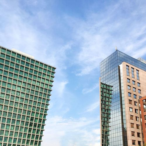 Low Angle View Of Modern Office Buildings Against Sky
