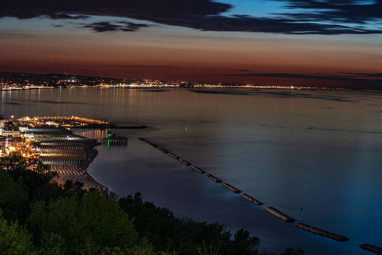 amazing view of Riviera Romagnola from Gabicce Monte, Italy Water Architecture Sky Building Exterior Nautical Vessel Transportation Illuminated Cloud - Sky Nature Reflection City No People Built Structure Mode Of Transportation Sunset High Angle View Sea Outdoors Cityscape Bay EyeEm Best Shots EyeEm Selects EyeEm Nature Lover EyeEm Sunset EyeEm Sunset Collection Gabicce  Gabicce Monte Gabicce Mare Rimini Riccione Riviera Romagnola Sunset #sun #clouds #skylovers #sky #nature #beautifulinnature #naturalbeauty #photography #landscape Italybeauty Long Exposure The Traveler - 2019 EyeEm Awards