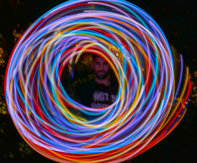 Full frame shot of multi colored light painting at night