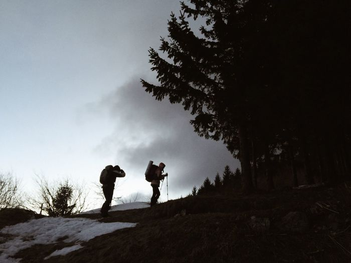 Side view of hikers on mountain during winter