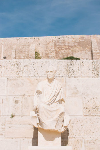 Statue at acropolis during sunny day