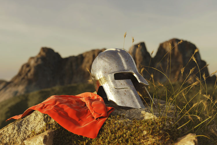 ancient greek Sparta type helmet with red cape laying on rocks in the evening sunset Sparta Spartans  Nature Ancient Helmet Warrior Cape  Cloak Iron Metal Grass Rocks Mountain Range Mountain Courage Laying Moss Highland Aged Environment Outdoors Red