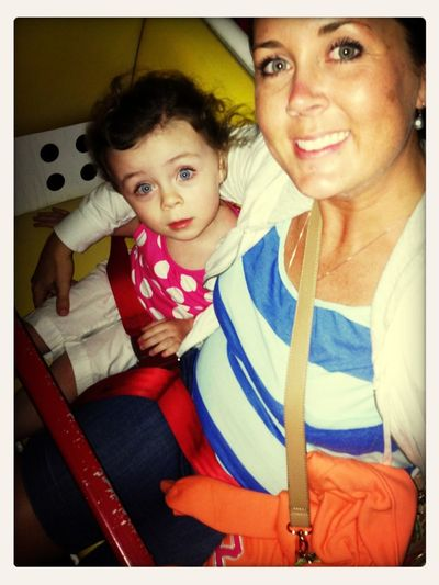 Riding the Ferris wheel... She loved the rides! Just like her momma!