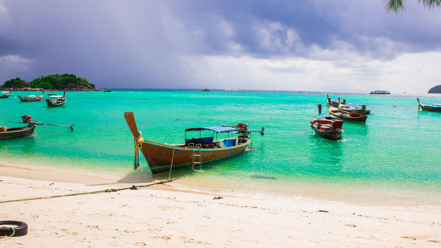 lipe island Thailand Anchored Beach Beauty In Nature Cloud - Sky Fishing Boat Horizon Horizon Over Water Land Longtail Boat Mode Of Transportation Moored Nature Nautical Vessel No People Outdoors Sand Scenics - Nature Sea Sky Tranquil Scene Tranquility Transportation Turquoise Colored Water