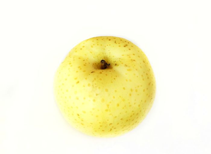 Fresh yellow Chinese pear on white background Fresh Chinese Pear Food And Drink Healthy Eating Yellow White Background Freshness Fruit Drink Food No People Healthy Lifestyle Close-up Indoors  Nature Day
