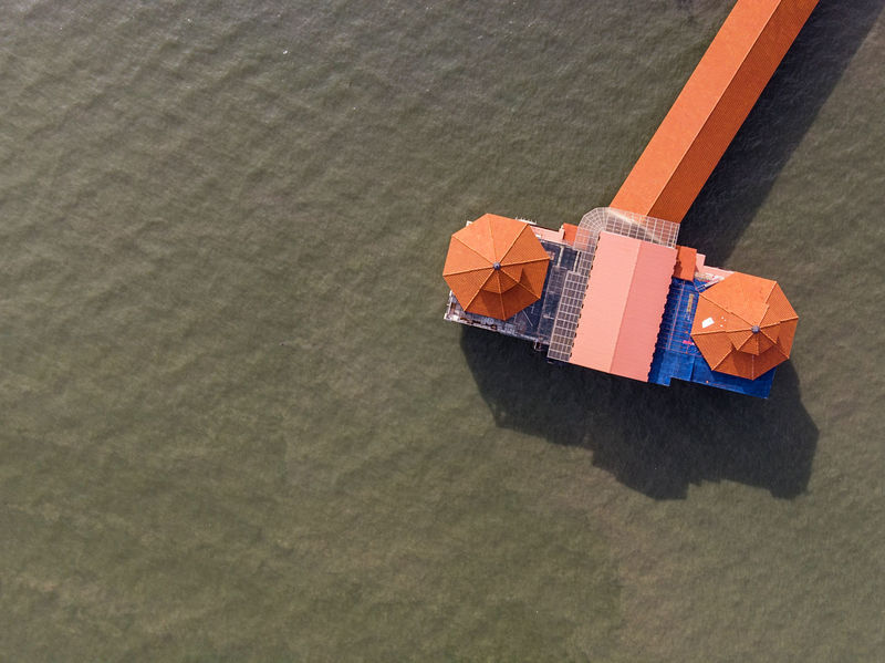 Aerial view of a Jetty roof top Bird Eyes View Rooftop Shape Absence Aerial View Beach Copy Space Day Directly Above High Angle View Jetty Nature No People Orange Color Outdoors Sea Water Shadow Sunlight