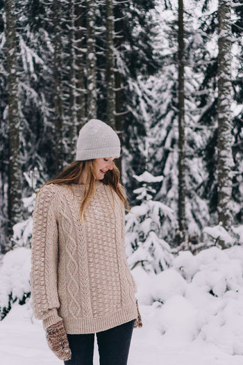 Woman standing on snow covered land