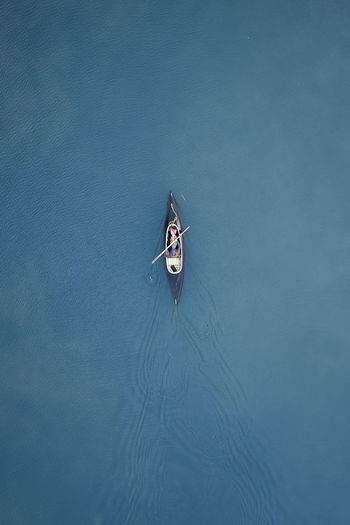 High angle view of person sailing on sea in canoe