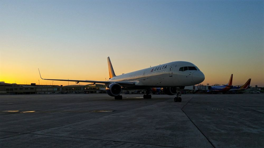 A Delta Airlines Boeing 757 Departing Milwaukee Mitchell International Airport in Wisconsin this past Evening Transportation Mode Of Transport Air Vehicle Airport Clear Sky Flying Sky AirPlane ✈ Airlines Public Transport Aviation Photography Sunset Airline Travel Transportation