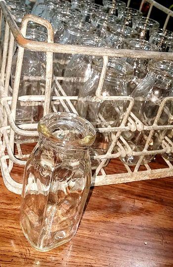 Milk Bottles Antique Old Vintage Old Glass Bottle Old Glass Wire Rack Milk Bottles And Rack Fresh On Eyeem