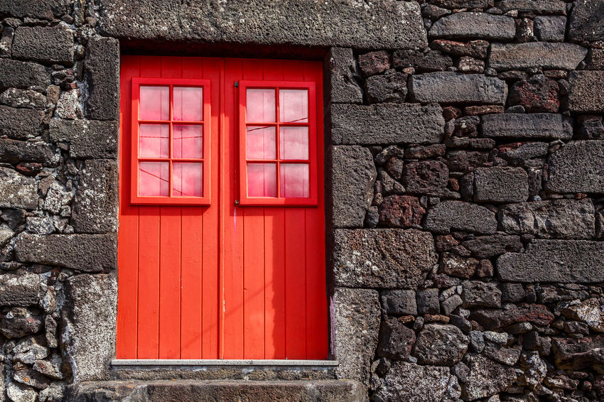 Azores Pico Island Architecture Basaltic Rock Brick Brick Wall Building Building Exterior Built Structure Close-up Day Door Entrance House No People Outdoors Red Safety Solid Stone Wall Tipical House Wall Wall - Building Feature