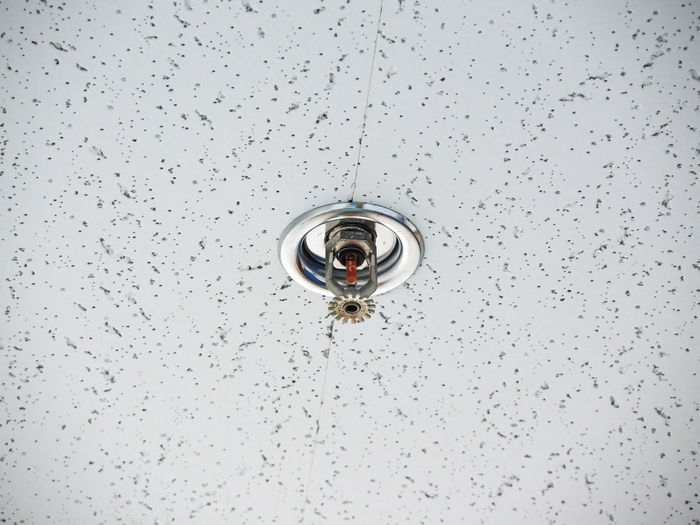Low angle view of fire sprinkle on ceiling