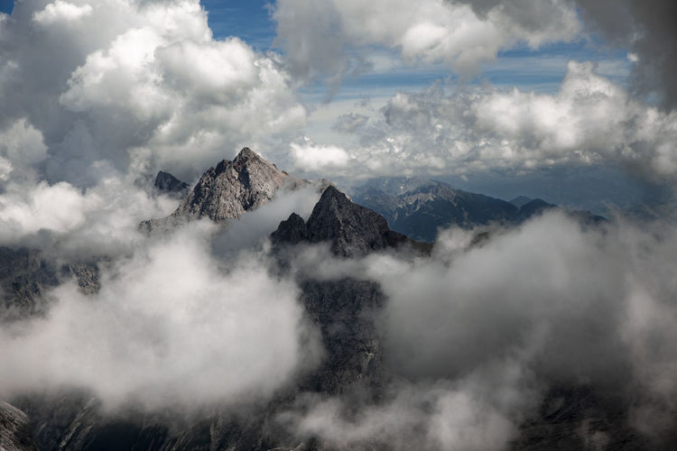 Mountain peaks were drowned in clouds
