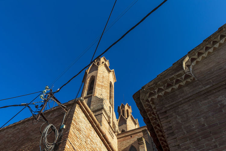 Low angle view of cathedral against clear blue sky