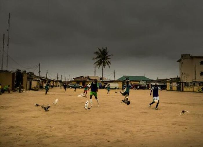 Football moment Football Bird Man And Animal Birdman Field Outdoors Outdoor Photography EyeEm Gallery EyeEmBestPics EyeEm Team Pigeon Soccer Local League Lagos Nigeria Color Of Life Home Is Where The Art Is