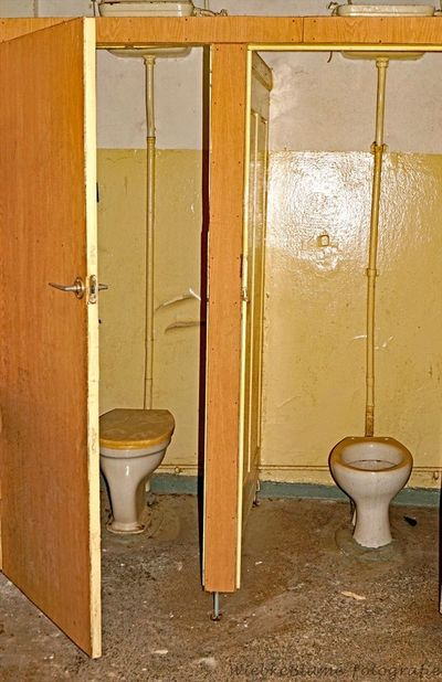 Lost Places Abandoned Architecture Bathroom Building Built Structure Day Domestic Bathroom Domestic Room Door Entrance Home Household Equipment Hygiene Indoors  No People Public Building Public Restroom Toilet Toilet Bowl Wall - Building Feature