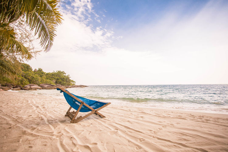 Beach Beauty In Nature Chair Day Horizon Over Water Nature No People Outdoors Palm Tree Sand Scenics Sea Sky Summer Sunlight Tranquility Vacations