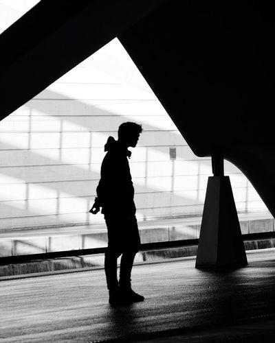 Silhouette man and woman walking in corridor