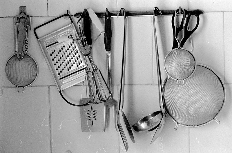 Various utensils hanging in kitchen