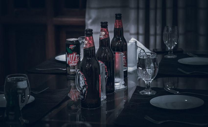Empty bottles on table in restaurant